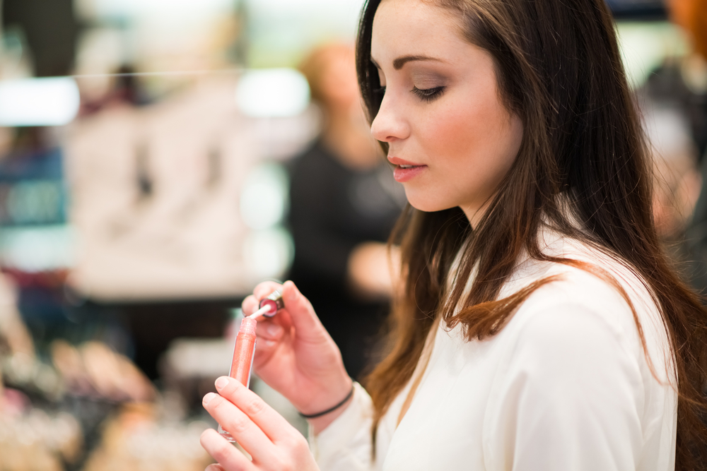 Woman trying out cosmetics