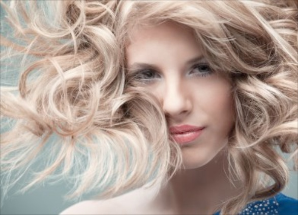 Young woman with windblown blonde hair