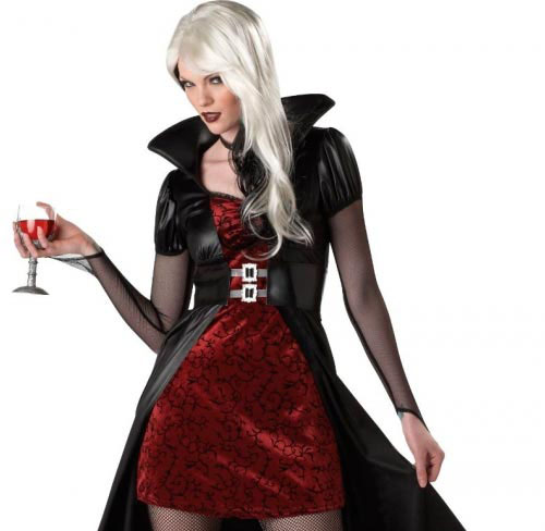 Woman with long white hair and edge vampire outfit