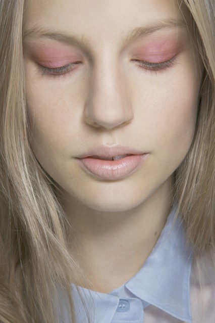 Woman with pale skin and pink eyeshadow