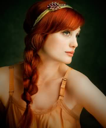 Model with long braided red hair