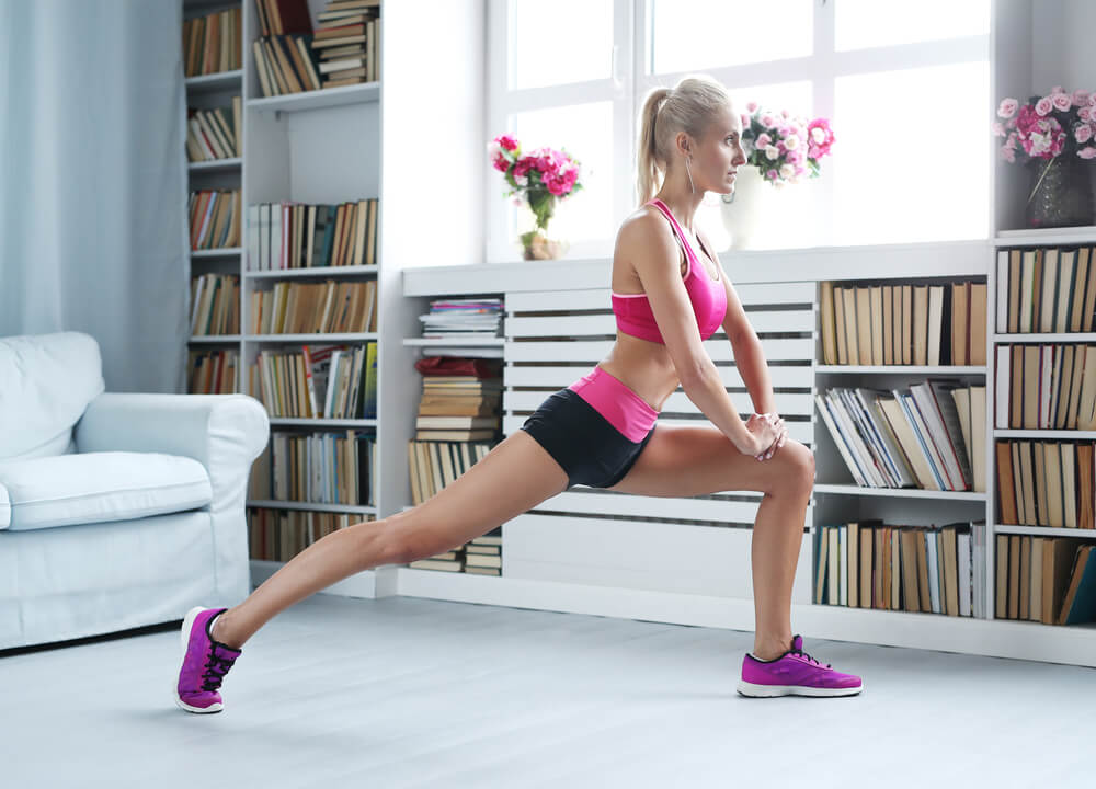 woman doing lunges indoors