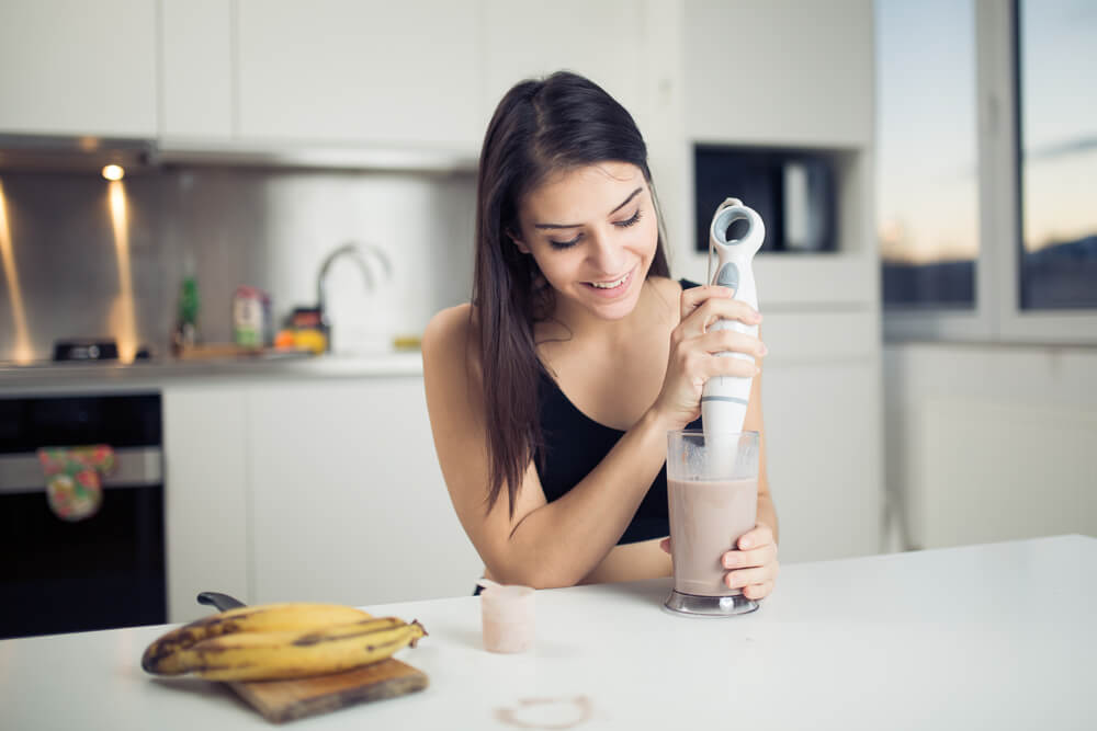 Woman making healthy milkshake