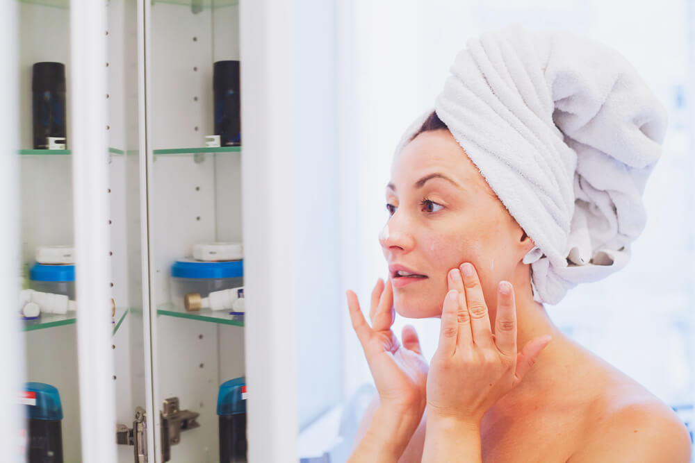 Woman using skin care