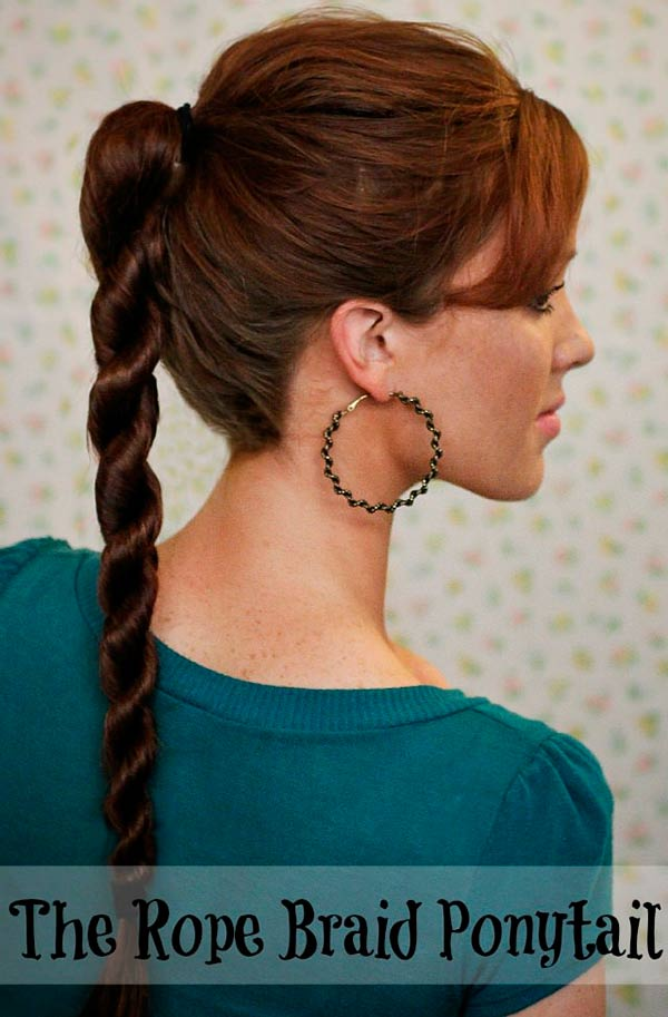 Woman with long twisted ponytail and large hoop earring