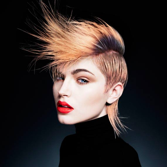 Woman with red lipstick and spiky orange-hued hair