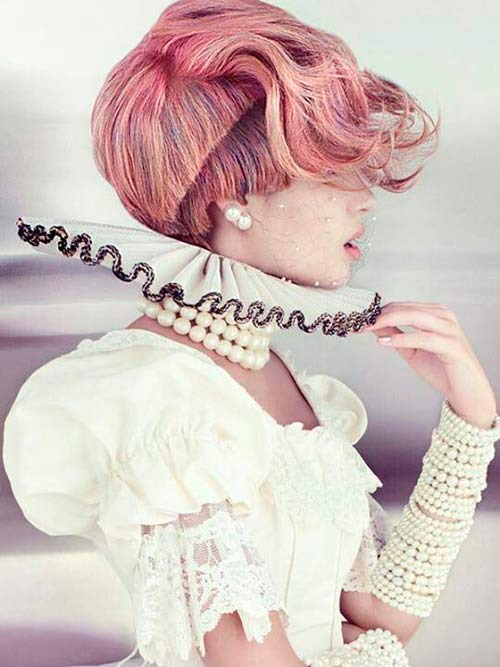 High fashion model with creative artistic pink hair updo