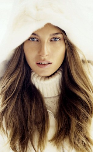 Woman with long wavy hair in winter clothing