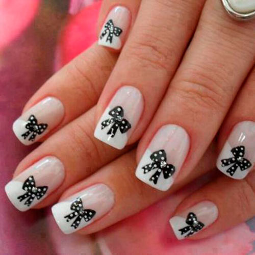 White-tipped nail art design with bow