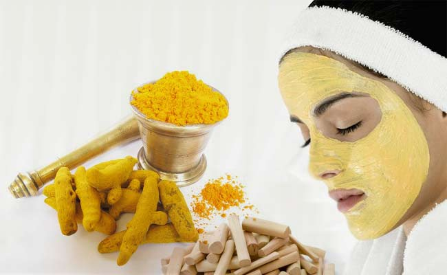 Turmeric root and woman with yellow facial mask