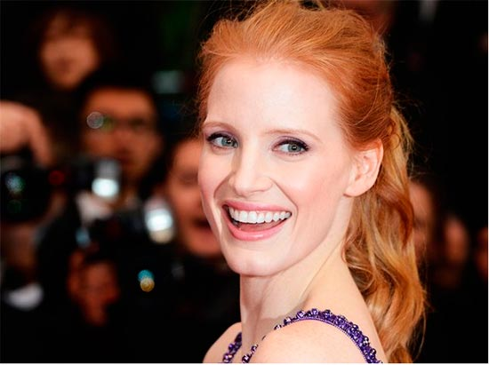 Jessica Chastain with red hair in a ponytail