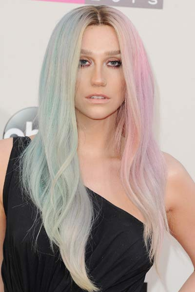 Kesha with middle-parted green and pink hair