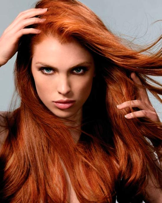 Woman with red hair and dark eye makeup