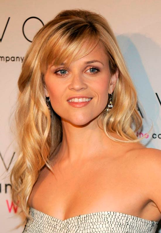 Reese Witherspoon with long wavy blonde hair and side-swept bangs