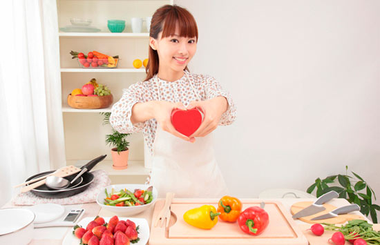 Japanese woman preparing fresh food in kitchen