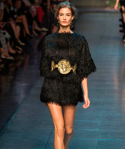 Runway model with large gold belt