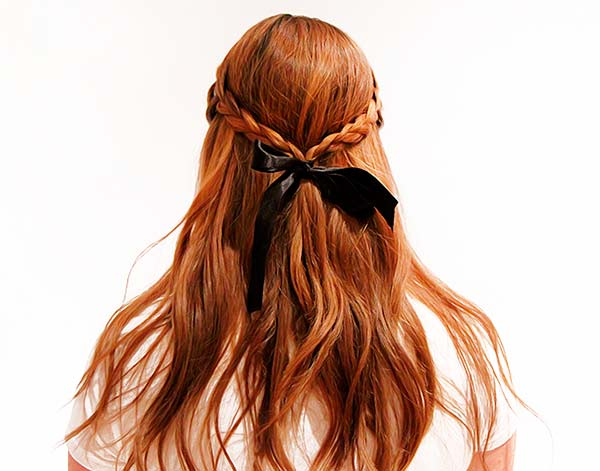Woman with braided hair and black ribbon