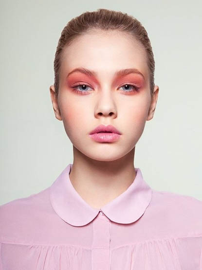 Model with pink eyeshadow and lipstick