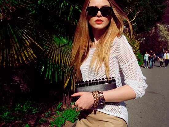 Stylish woman with long hair in sunglasses