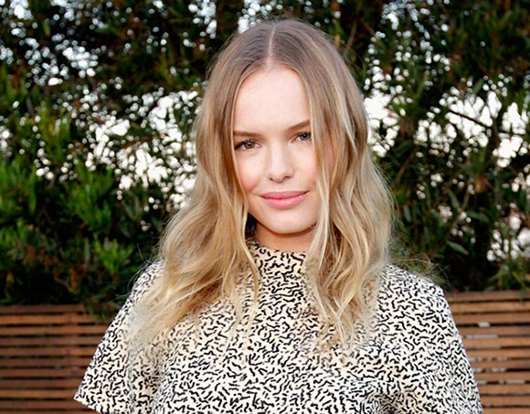 Kate Bosworth with middle-parted wavy hair and nude makeup