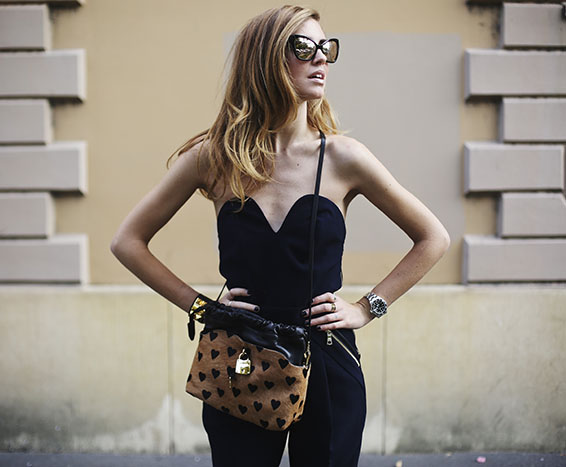 Woman in jumpsuit and bag