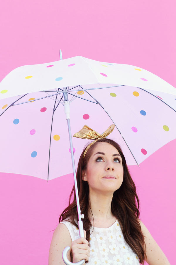 Woman with colorful polka-dotted umbrella