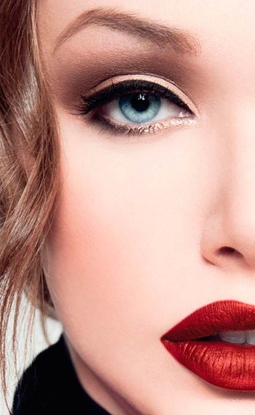 Model with dark eye makeup and red lipstick