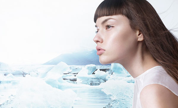 Woman with sleek brown hair against snowy ice cap background