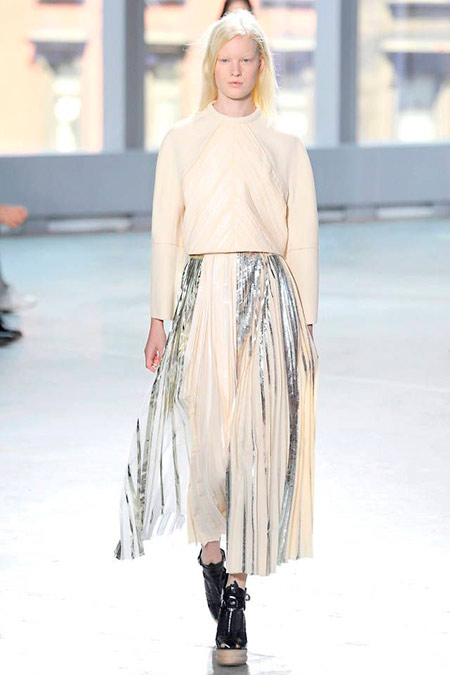 Runway model in sheer pleat skirt