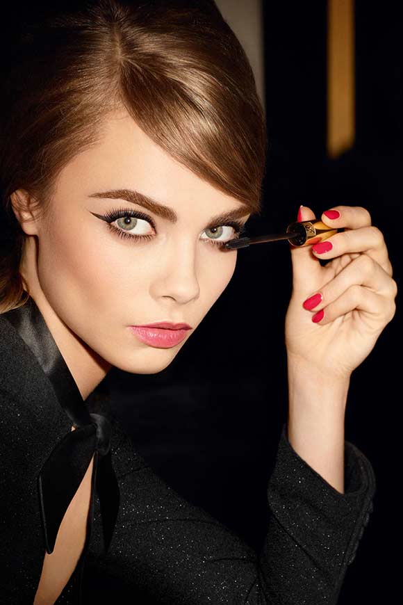 Cara Delevingne with dark eye makeup and red lipstick