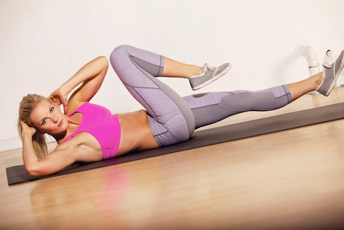 Woman doing crunches on floor