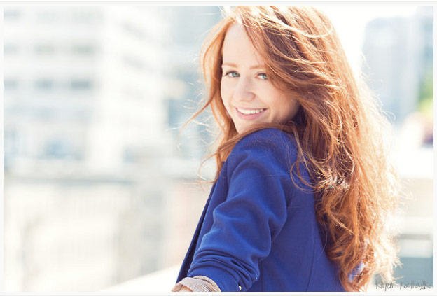 Woman with red hair outdoors