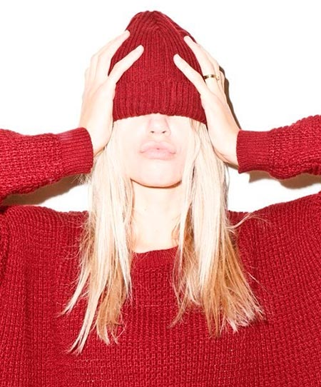 Woman in red sweater and red beanie