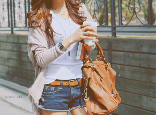 Fashionable woman with brown holdall bag