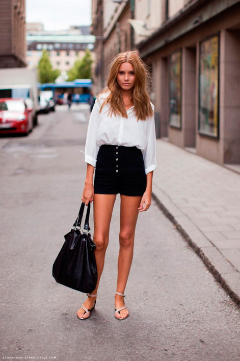 Woman in white top and black mini skirt