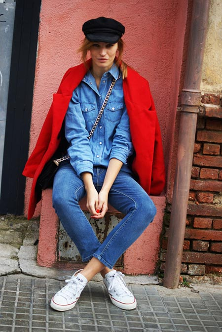 Fashionable woman with sneakers and red coat