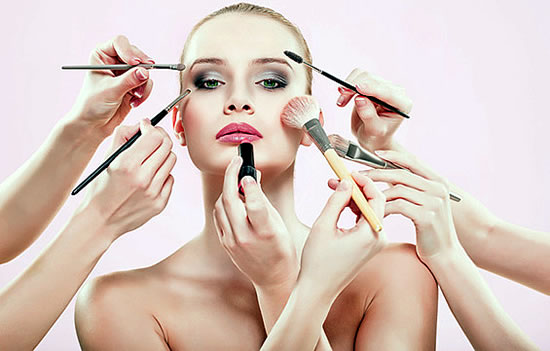 Model with various makeup tools