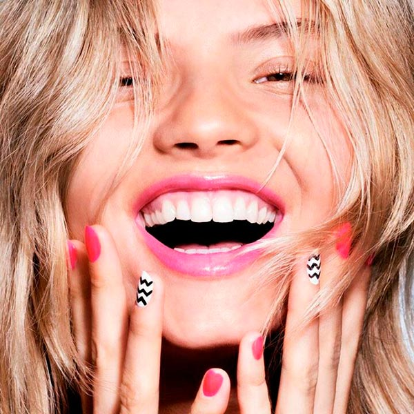 Woman with pinkish-red manicure