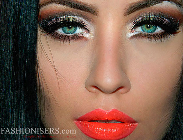 Woman with green eyes and heavy makeup with red lipstick