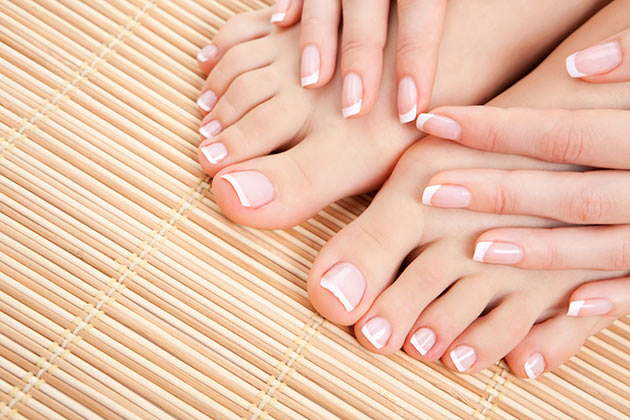 Woman's hands and feet with French manicure