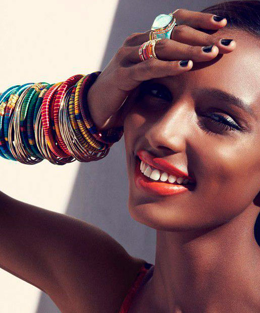 African American model with scarlet lipstick and bangles on arm