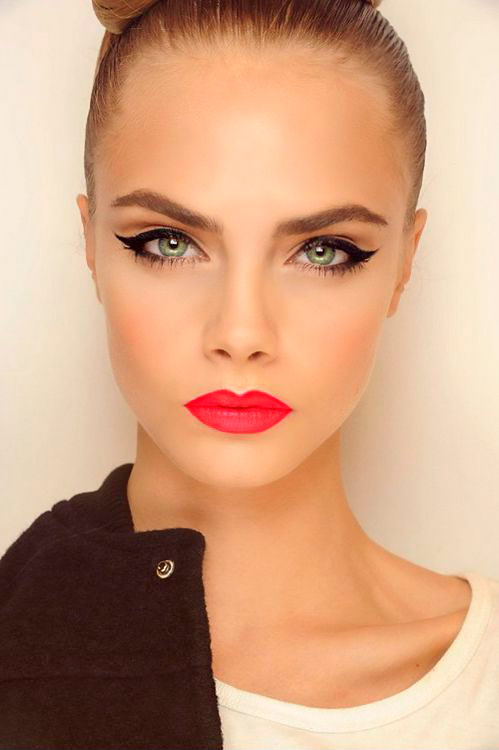 Woman with black eyeliner and red lips