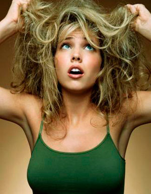 Woman holding up messy hair