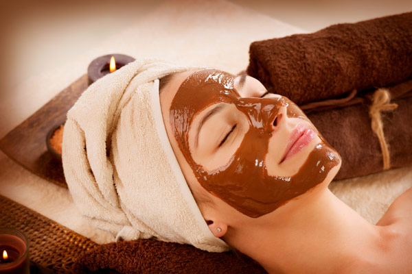 Woman relaxing with face mask