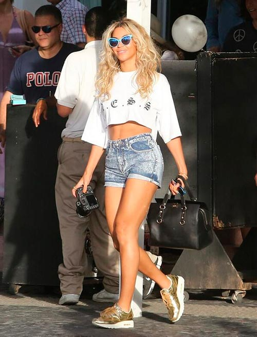 Woman wearing sneakers with denim shorts