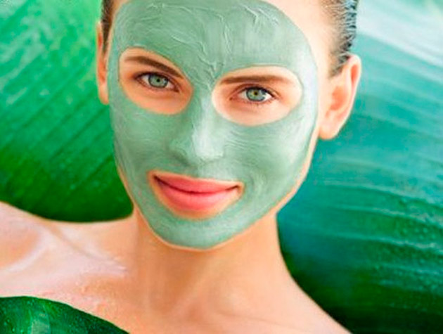 Woman in green clay face mask