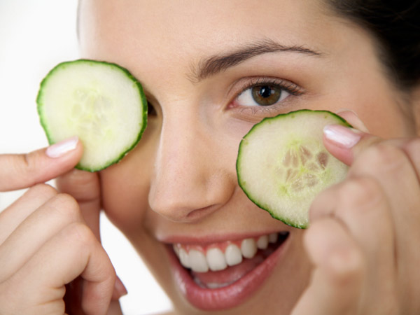 Woman with cucumber slices
