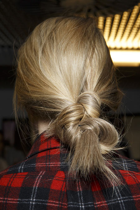 Back of woman's head with low knot hairstyle
