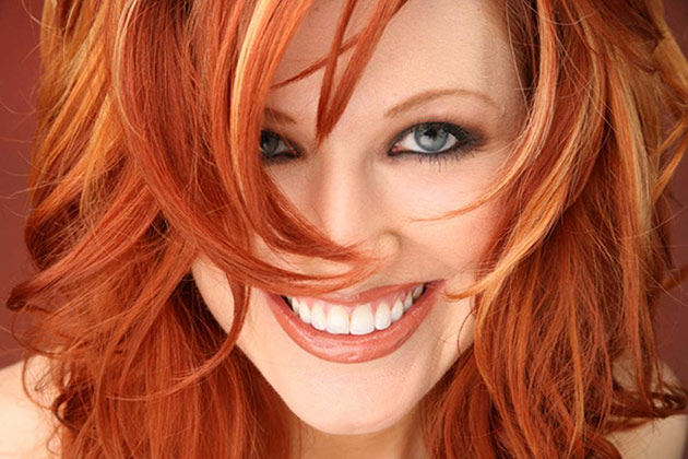 Smiling woman with rich red hair