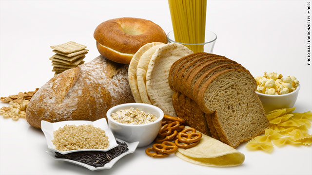 Assorted bread and grains on white background